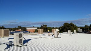 repairing AC units on roof tops